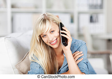 Blond female calling at home