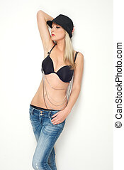 Blond female fashion model posing in black bra and jeans