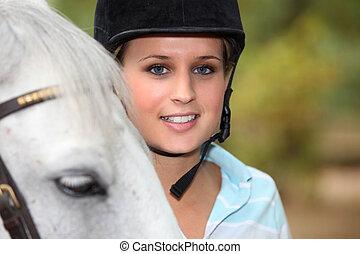 Blond female horse rider