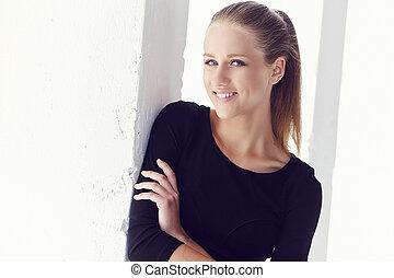 Blond female in black dress.