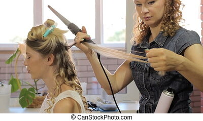 Blond Female In Hair Salon. Hairdresser On Background.