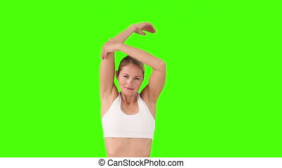 Blond female in sportswear doing exercise