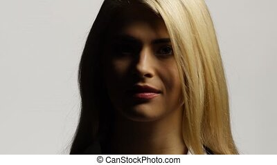 Blond female model with her long hair. White
