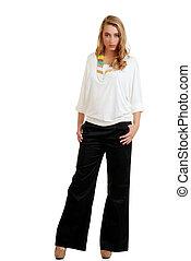blond female wearing black pants