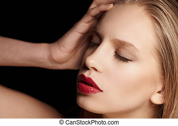 Blond female with red lips.