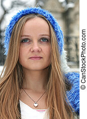 Blond freckled girl with blue hat