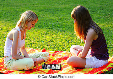Blond friends playing chess