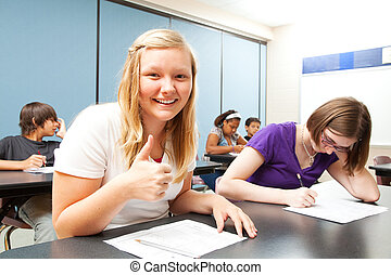 Blond Girl Aces Test in School - Pretty blond teen gives a...