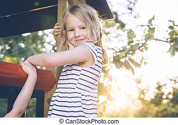 Blond girl at a playground