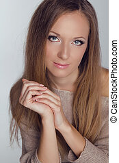 Blond Girl. Beautiful woman with long straight hair. Fashion model posing at studio. Haircare. Natural Beauty