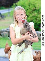 blond, girl, dans jardin, à, poulets