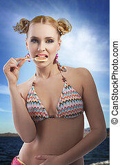 blond girl eating candy