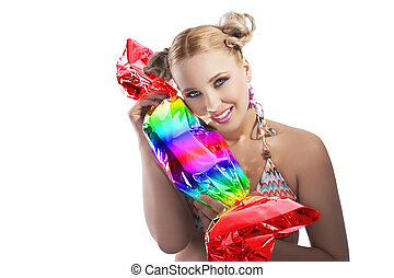 blond girl funny playing with candy