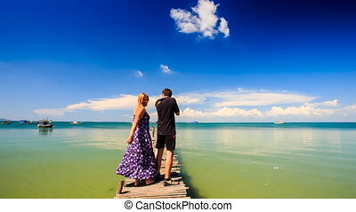 Blond Girl Guy Stand on Wooden Pier she Arms he Photos Sea