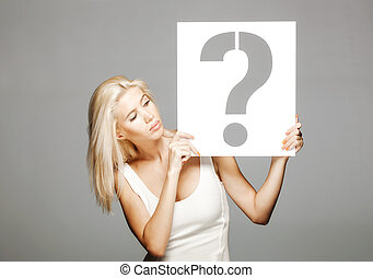 blond girl holding a question mark sign