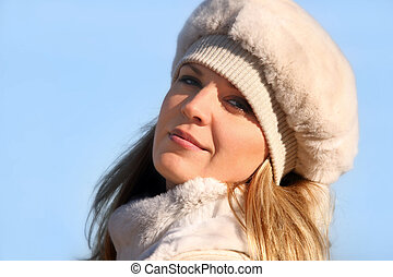Blond girl in a fur hat