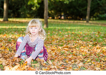 blond girl in autumn meadow