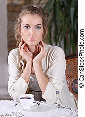 Blond girl in cafe