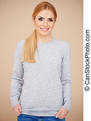Blond girl in casual grey sweater