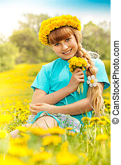 Blond girl in dandelions
