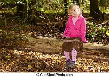 blond girl in forrest