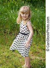 blond girl in grass