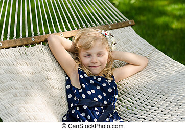 blond girl in hammock