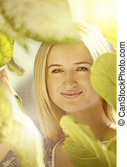 Blond girl in leafs