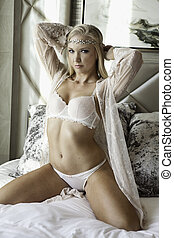 Blond girl in lingerie