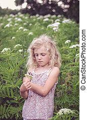 blond girl in meadow