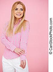 Blond girl in pink, standing full-length