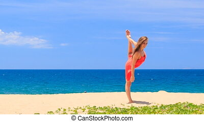 blond girl in red shows position hands leg scale on sand