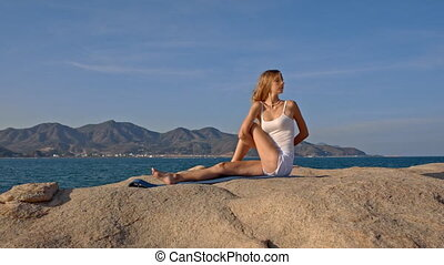 Blond Girl in Top in Yoga Pose Hands behind Back