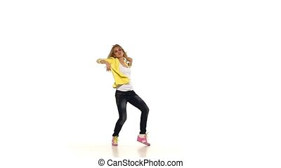 Blond girl in yellow shirt dancing sexy-jazz modern style on white background, slow motion