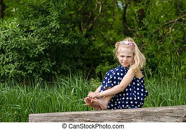 blond girl on bench