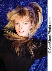 blond girl on blue background