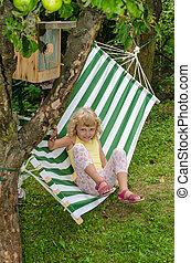 blond girl on hammock