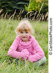 blond girl on meadow