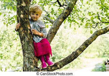 blond girl on tree