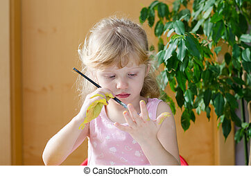 girl painting with brush