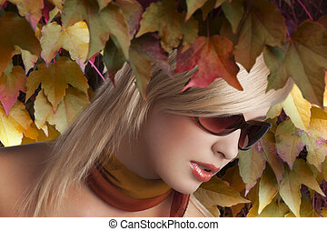 blond girl portrait with stylish sunglasses