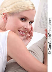 Blond girl reading book