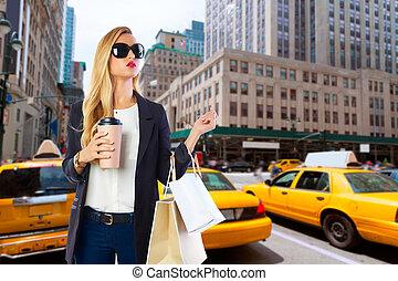 Blond girl shopaholic in Manhattan New York