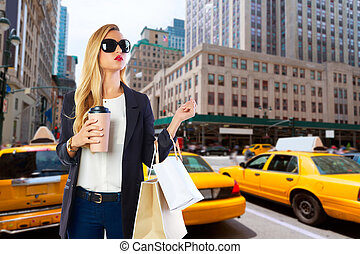 Blond girl shopaholic in Manhattan New York