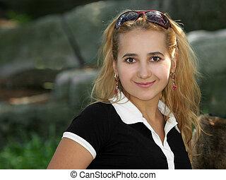 Blond girl smiling
