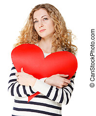 Blond girl with big red valentine card
