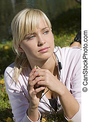 blond girl with earphone