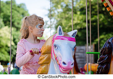 blond girl with face-painting