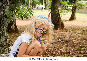 blond girl with facepainting