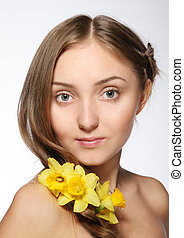 Blond girl with flowers in her hair